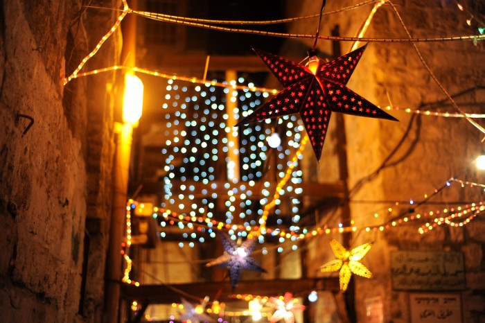 Decorations in the streets of the Old city of Jerusalem at night during Ramadan, including a star paper lantern