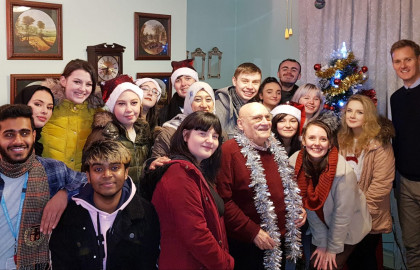 Terrence (centre right) with Oldham College students on the day they brought him a Christmas tree.